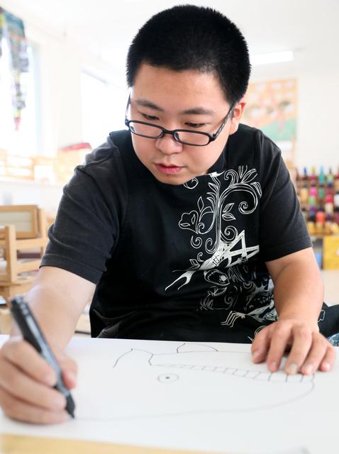 伊藤彬さん自閉症の男性が描くタウンページ表紙9-6