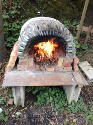 ピザ釜で焼く