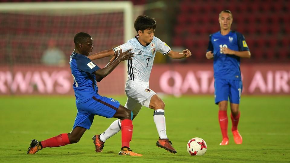 Kubo of Japan and Claudio Gomes of France battle for the ball