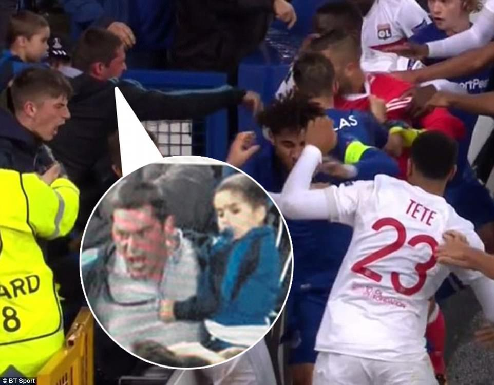 Everton fan carrying a child slaps Lyon goalkeeper Anthony Lopes on his head