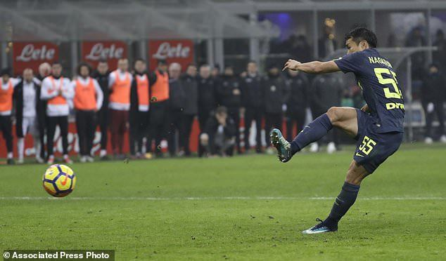 Inter Milans Yuto Nagatomo scores the decisive penalty during the Italian Cup
