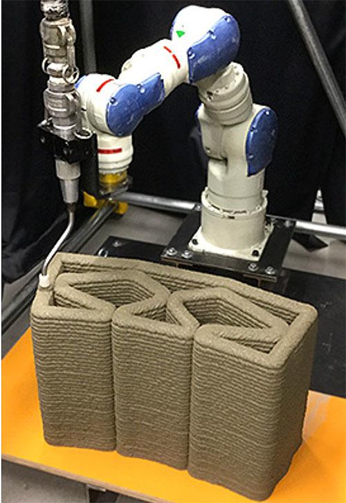 特殊なセメント系材料を用いた3Dプリンターを開発